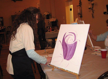 Taste & Paint guest working on a painting